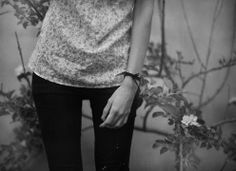 leggings & floral t-shirt and black bracelet