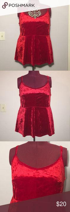 """Torrid Red Velvet Peplum Tank Top Up for grabs is this top from Torrid. It is a Torrid size 3, equivalent to a size 22 / 24 , and measures 29.5"""" from shoulder to hem (adjustable) with a 47"""" bust and a 44"""" waist, both unstretched. This tank top is a peplum style with chunky adjustable straps. It has a v-neckline and rear v-shoulder line. This top is a lush velvet in a cherry red and stretches nicely. It is new with the original tag. torrid Tops Tank Tops"""