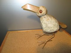 the bird made of granit, steel and glass