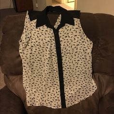 XL Animal Print Tank Top Button down tank top has notched back neckline.  Size XL.  Ivory with black animal print.  Made by A Beyer.  Great condition.  Important:  I make sure all items are freshly laundered as applicable (shoes and tagged items, I don't remove the tags and wash).  However, not all my items come from pet/smoke free homes.  Low pricing reflective of this. Thank you for looking! Tops Tank Tops