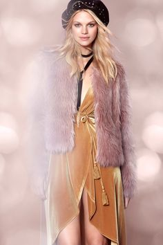 Nadine Leopold wears faux fur jacket and velvet dress from Forever 21