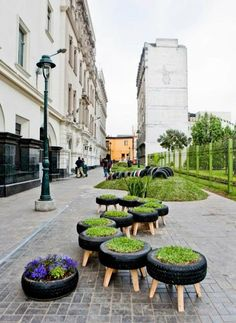 Tire Art & Planters - great idea to make tires into outdoor seating stools