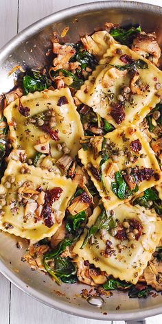 Ravioli with Spinach, Artichokes, Capers, Sun-Dried Tomatoes. Vegetables are sautéed in garlic and olive oil. #Italian #Mediterranean #pasta