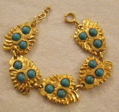 bracciale rita frascione in metallo dorato e turchese