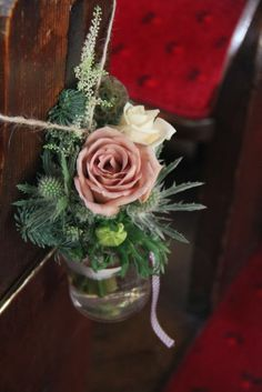 Fabulous Winter Wedding at St Lawrence's Church Longridge : Posies in dressed Jam Jars filled with a country collection of Astilbe, Roses, Astrantia, Scabious and Thistles were attached to the end of each alternate Pew