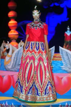 Red lengha by  Manish Arora at Delhi Couture Week 2013.