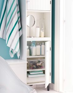 The key to this bathroom's easy transformations is plenty of closed storage. A tall SILVERAN cabinet provides plenty of room for bath things, lotions and towels.