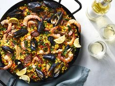 Nourishing, vibrant, and without pretension, paella has held a place of honor and practicality in Spanish homes for centuries. To round out this meal, Chicken Broth Recipes, Fish Recipes, Seafood Recipes, Cooking Recipes, Cooking Rice, Seafood Paella, Seafood Dishes, Paella Pan, Spanish Food