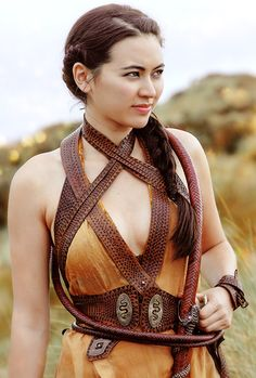 "Nymeria Sand (often called ""Nym"" for short) is a recurring character in the fifth and sixth seasons, though she had already been alluded to in Season 4. She is played by Jessica Henwick and debuts in ""Sons of the Harpy"". Nymeria Sand is the second of the eight bastard daughters of Prince Oberyn Martell, known as the ""Sand Snakes"". Nymeria's mother was an Eastern noblewoman, who taught her how to use a whip in combat, but who later died in battle. Nymeria became very skilled with using her…"