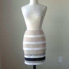 Layered pencil skirt dot Fully lined, textured layers down front and back, fabric content is linen, polyester, rayon and spandex, waist 35.5 inches, hip 44.5 inches, length 20.5 inches White House Black Market Skirts Pencil