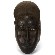 """African carved ceremonial Baule mask; Ivory Coast. Approx. 10""""H x 5""""W."""