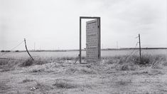 """""""Border Door"""" by Richard Lou is photographed by Jim Elliot. The door can only open towards the United States. The Mexican side of the door is adorned with 134 keys. Jim Elliot, Street Magic, Public Art, Public Transport, Installation Art, Welcome, Utility Pole, United States, Doors"""