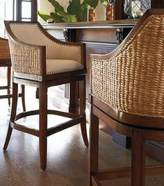 Sheldon beautifully captures the light, natural look of woven seagrass. Handcrafted of hardwood mahogany, the exterior back is covered in seagrass for island-inspired style, while the padded seat and back upholstered in a breezy linen or a supple leather for classic comfort.