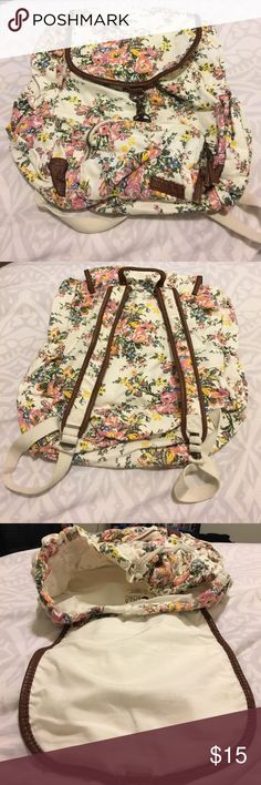 Billabong For Keeps White Floral Print Backpack Gently Used. Brown Vegan Leather. Two side water bottle pockets. Draw string to open close interior. Brass clasp for top flap. One of the backpack straps's metal is bended so cannot be adjusted (as seen in photos). Billabong Bags Backpacks