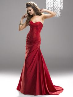 Flirt Prom by Maggie Sottero VALENTINE RED PF2149 -Bring some red carpet drama to your prom with this fit and flare dress. Exposed boning and sweetheart neckline keep all eyes on you as you make your way down the dance floor. Corset back closure.