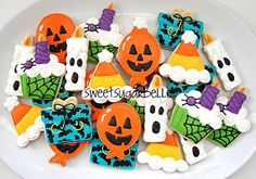 Halloween Birthday Cookies. Very cute, too bad i have no clue how to decorate cookies...