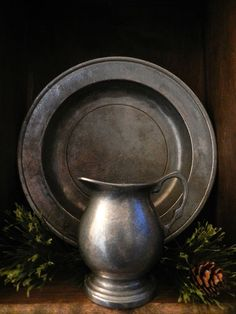 pewter...I have an almost identical set that I need to find a place to display! This looks so polished and classy!