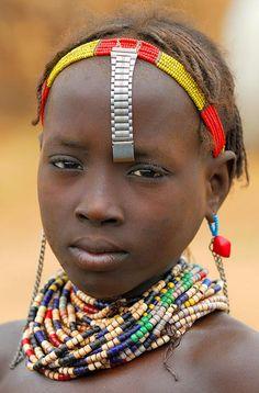 Daasanach tribe girl - Omorate Ethiopia- watch band as headdress