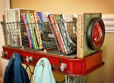 Repurposed Red Rider Wagon Table with Vintage Singer Sewing Machine Base and Wire Gym Basket Storage.  Features Wagon Wheels, Vintage Yardsticks, Chrome Faucet Handles and Much More!  By GadgetSponge.com