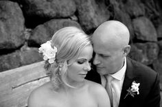 black and white close up of bride and groom with their heads resting together