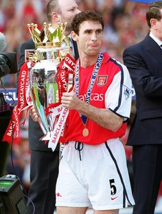 Martin Keown holding the Premiership trophy
