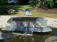 One of Toru Oba's Magnificent Soapstone Sculptures. On display on the Garden Walk at Southern Grace. You can see a video of this and other fountains on our web-site.