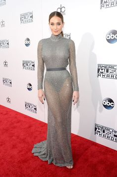 Hannah Davis rocks a sheer silver gown to the 2015 American Music Awards