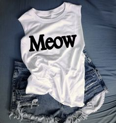 Meow cropped tank and ripped high waisted jean shorts- perfect for music festival season!