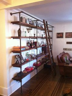 Adjustable shelves made from black iron piping and salvaged wood boards. Shelving units can be made to dimension with as many levels as you want.