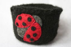 black wool felted vessel with ladybug by amothersgarden on Etsy