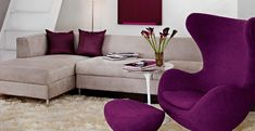 I chose this image because the chair is really attractive. I like the purple hue and the curved lines in the chair design which gives the room an inviting feeling. The ottoman, the flowers and the cushions match the hue that I like. Living Room Grey, Living Room Furniture, Living Room Decor, Painted Lady House, Purple Rooms, Chair Design, Design Design, Decoration, Living Room Designs