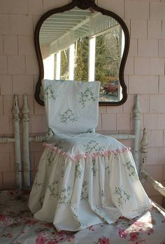 The solid pink adds the perfect touch on this slipcovered chair.