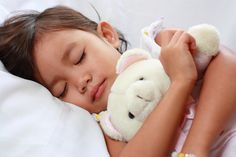 sleeping girl, sleeping with stuffed animal, hugging animal at bed, sleep habits, healthy sleep for toddlers, sleep training, learning to sleep alone, help with kids sleep,