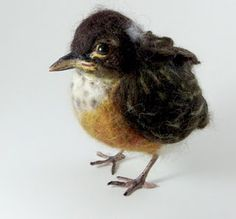 Baby robin by Robin Joy Andreae. She has lots of really lovely felted animals on her site.