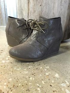 """A closed-toe desert wedge fashioned in synthetic leather and designed with metallic highlights that are sure to brighten up any look, day or night. Heel height: 2 3/4"""" Toms run true to size Made in Ch"""