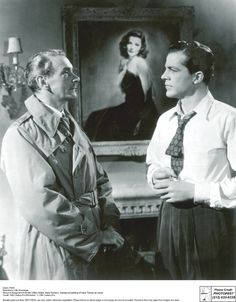 The two men that loved her, flanking the infamous portrait of Laura. What a romance