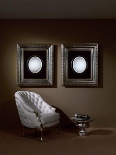 wall mirror with frame in silver and capitonne armchair in white leather for luxury furnishings #mirror #picture #armchair #luxuryfurnishing #furnishing #design #interiordesign #homedecor