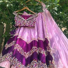 Beautiful Silk and raw silk Lehenga-Choli with hand work embellishments. Paired with net dupatta. Indian Gowns Dresses, Indian Fashion Dresses, Dress Indian Style, Indian Designer Outfits, Half Saree Designs, Choli Designs, Lehenga Designs, Half Saree Lehenga, Anarkali