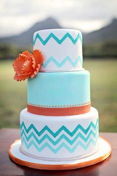 3-tier orange and turquoise chevron cake with orange sugar peony accent.  By A Cake Life - www.acakelife.com