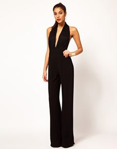 Night Out on the Town? Try this sexy alternative to your usual mini-dress  Enlarge Aqua Laurent Backless Halterneck Jumpsuit