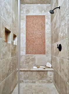 Bathroom design trend #6: Large, spacious showers, with an ample seat that also serves as a decorative feature in the bath.