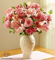 Lovely in Lenox® Bouquet -Make sure their day is as lovely as they are when you send this fresh, delicate bouquet, designed in our exclusive Lenox® vase! Our expert florists artistically arrange soft pink roses, lilies and more inside this exquisite Lenox® porcelain vase, featuring a raised, stylized floral design and 24 karat gold trim at the base. Both classic and beautiful, it's a memorable gift they'll treasure always