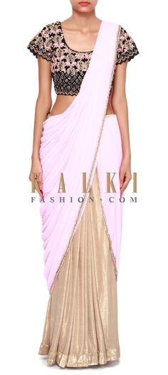 Buy Online from the link below. We ship worldwide (Free Shipping over US$100). Product SKU - 307318.Product Link - http://www.kalkifashion.com/pink-and-gold-lehenga-saree-adorn-in-kundan-and-resham-embroidery-only-on-kalki.html