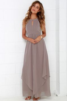 When you're dreaming about the Dream Girl Taupe Maxi Dress you won't want to wake up! Elegant chiffon in a lovely taupe (with lavender undertones) shapes a high, halter neckline above a sleeveless pin-tucked bodice embellished by a front keyhole. Panels of chiffon flutter atop the sweeping maxi skirt as it falls effortlessly from a fitted, empire waist. Back keyhole has a two-button closure. Hidden zipper/hook clasp at back. Fully lined. Self: 100% Polyester. Lining: 95% Polyester, 5%…