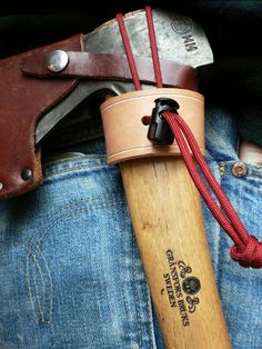 """The Damn Yak Dry Goods Axe Holster. Simple in form, and strong to deliver. 12 oz. Veg Tanned Tooling leather. Leather is flat brass riveted on either side by hand through all layers of leather equaling 1/2"""" thick. The flat rivets prevent marring on your waistband as well as your axe"""