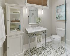 This vanity offers a sleek look.  I love the idea of ceiling pendant lights!