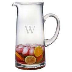 Serve lemonade and iced tea at your next soiree with this eye-catching glass pitcher, showcasing a personalized monogram accent.  Product...