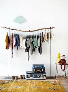 Branch used as clothes rod - http://www.beautifuldiy.net/branch-used-as-clothes-rod