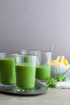 Drink Your Greens Smoothie with three kinds of leafy greens, pineapple, and coconut milk -- ready for your add-ins (chia or hemp seeds would be great)