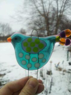 Fused glass bird.